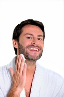 30 years old man shaving off his beard