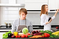 Man unhappy with cooking sitting in kitchen