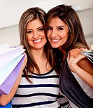 Beautiful shopping women at the mall holding bags