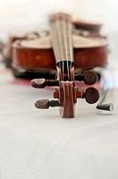 An old wooden violin close up