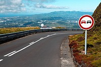 Empty road with turn and traffic sign. Sao Miguel island, Azores islands, Portugal