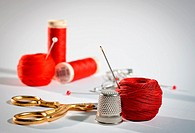 A sewing kit in red, landscape.