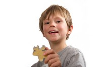 Boy showing his cookie, an elk, made for christmas