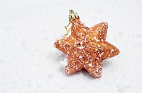 a golden christmas star on the snow
