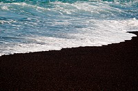 Black volcanic sand on the beach of El Golfo bay on Lanzarote, Canary Islands, Spainolfo bay on Lanzarote, Canary Islands, Spain
