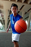 Asian male Basket ball Player at night