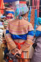 People's market, woman in the costume of the Hmong ethnic minority, Flower Hmong ethnic group, Sin Cheng, Si Ma Cai District, Vietnam, Asia