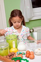 girl in kitchen prepearing a delicious cake