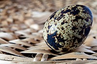 close up of quail eggs on wicker basket