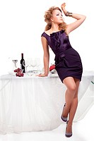 Portrait of beutiful woman standing nea table in restaurant