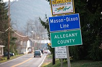 Signs at the Mason Dixon line welcomes travelers to Maryland