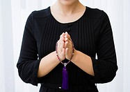 Woman with hands together in prayer Mourning image