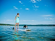 Woman on paddle board with dog