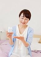 Senior woman holding supplements