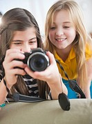 Close up of two girls using camera