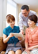 Family using tablet PC