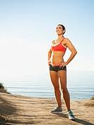 Woman training on coast