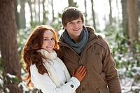 Young couple embracing in winter scenery