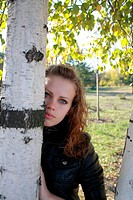 The beautiful lonely young girl near a birch