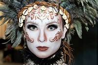 Woman with tribal make-up with feathers, London, England, United Kingdom, Europe