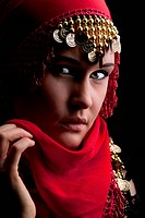 a beautiful woman wearing a red exotic veil