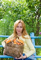 Basket, full mushrooms, and young woman_mushroom picker