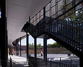 Cotham School, Walters and Cohen, Bristol, United Kingdom, 2010, Low Angle View of Staircase, Spine, Screening and Schoolyard, WALTERS AND COHEN, UNIT...