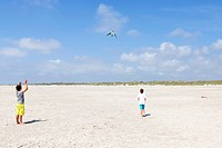 Children flying kites, Kniepsand sandbank, Amrum island, North Friesland, Schleswig-Holstein, Germany, Europe