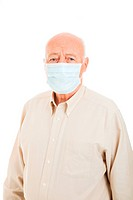 Senior man wearing a surgical mask to protect against flu epidemic. Isolated on white.