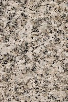 Natural white granite rough stone surface close up background.