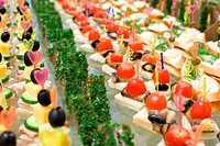 a lot of canapes with skewer on buffet table, shallow DOF