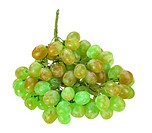 Single bunch of green grape. Close_up. Isolated on white background. Studio photography.