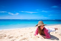 Happy young woman on white sand tropical beach