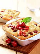 Cherry sponge cakes in ceramic dishes