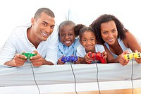 Animated family playing video game lying down on bed at home