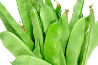 a pile of french beans isolated on a white background