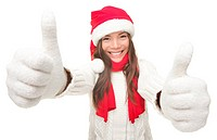 Christmas woman thumbs up success hand sign. Young smiling woman in Santa hat and warm winter sweater. Isolated on white background.Funny photo of Asi...
