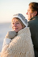 Happy senior couple wearing winter hat and sweater