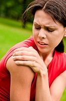 Shoulder injury _ sportswoman in pain