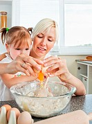 Relaxed mother and child baking cookies in kitchen