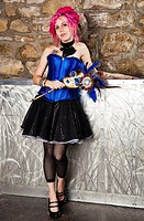 Young woman dressed in steampunk style with pink hair