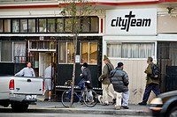 In the evening, homeless people of both sexes enter CityTeam Ministries on 6th Street in San Francisco. Note manager at left. The organization provide...
