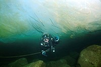 Diver, ice-diving, in Lake Baikal, Olkhon island, Siberia, Russia, Eurasia
