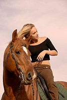 riding girl and her brown stallion. focus on the teen