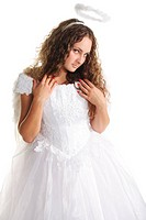 Beautiful young serious woman in white angel dress
