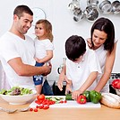 Loving young family cooking together in the kitchen
