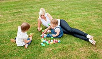 Family playing with toys on the grass