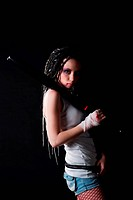 beauty girl with baseball bat and with blood on her fist on black background