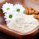 fresh almond bran powder in bowl closeup