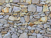 Layered stone wall structure and pattern.
